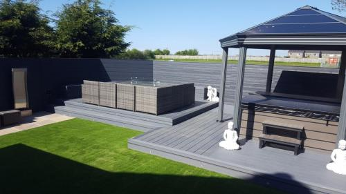 1. Grey composite deck with grey cladding and gazebo