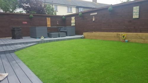 11. Artificial grass with light grey composite deck