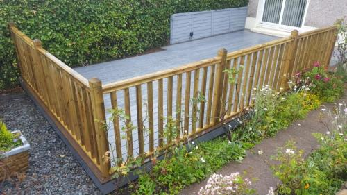 14. Light grey composite deck with Walnut edging and timber balustrades