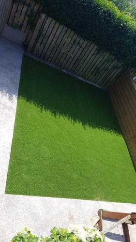15. Artificial grass back yard