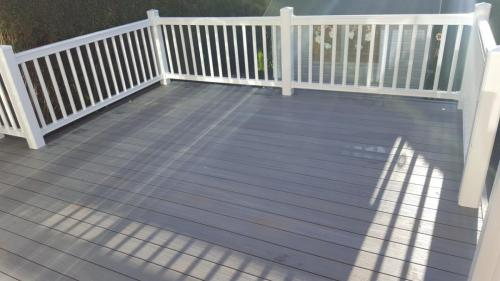 15. Light grey composite deck with white plastic balustrades