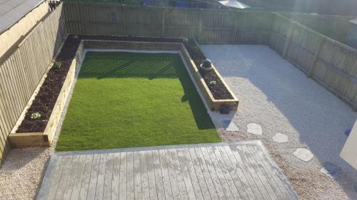 16. Artificial grass with planters