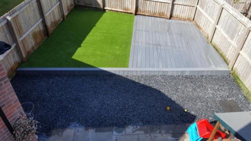 2. Artificial grass and light grey composite deck