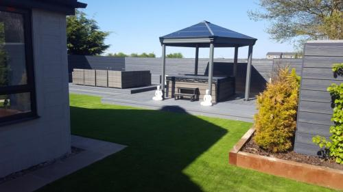 24. Grey deck with artificial grass and cladding