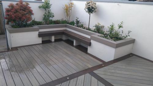 3. Antique deck with walnut edging, seating area and planters