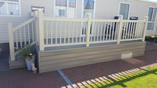 32. Antique deck with Cream plastic handrails