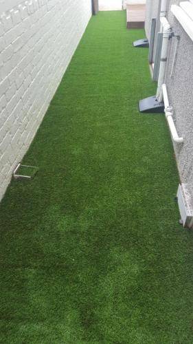 4. Artificial grass put in back yard