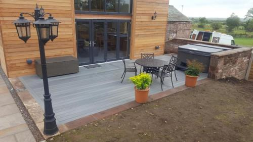 40. Light grey deck with cottage