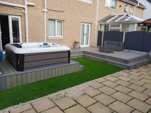 49. Antique deck with light grey edging and artificial grass