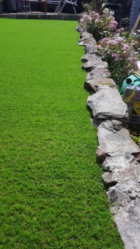 5. Artificial grass cut to stone shapes
