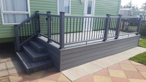 6. Light grey deck with composite handrails