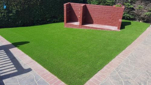 9. Artificial grass back yard